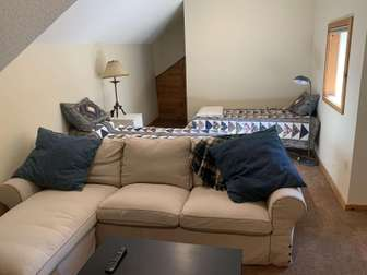 Loft with two twin beds, couch, tv. thumb