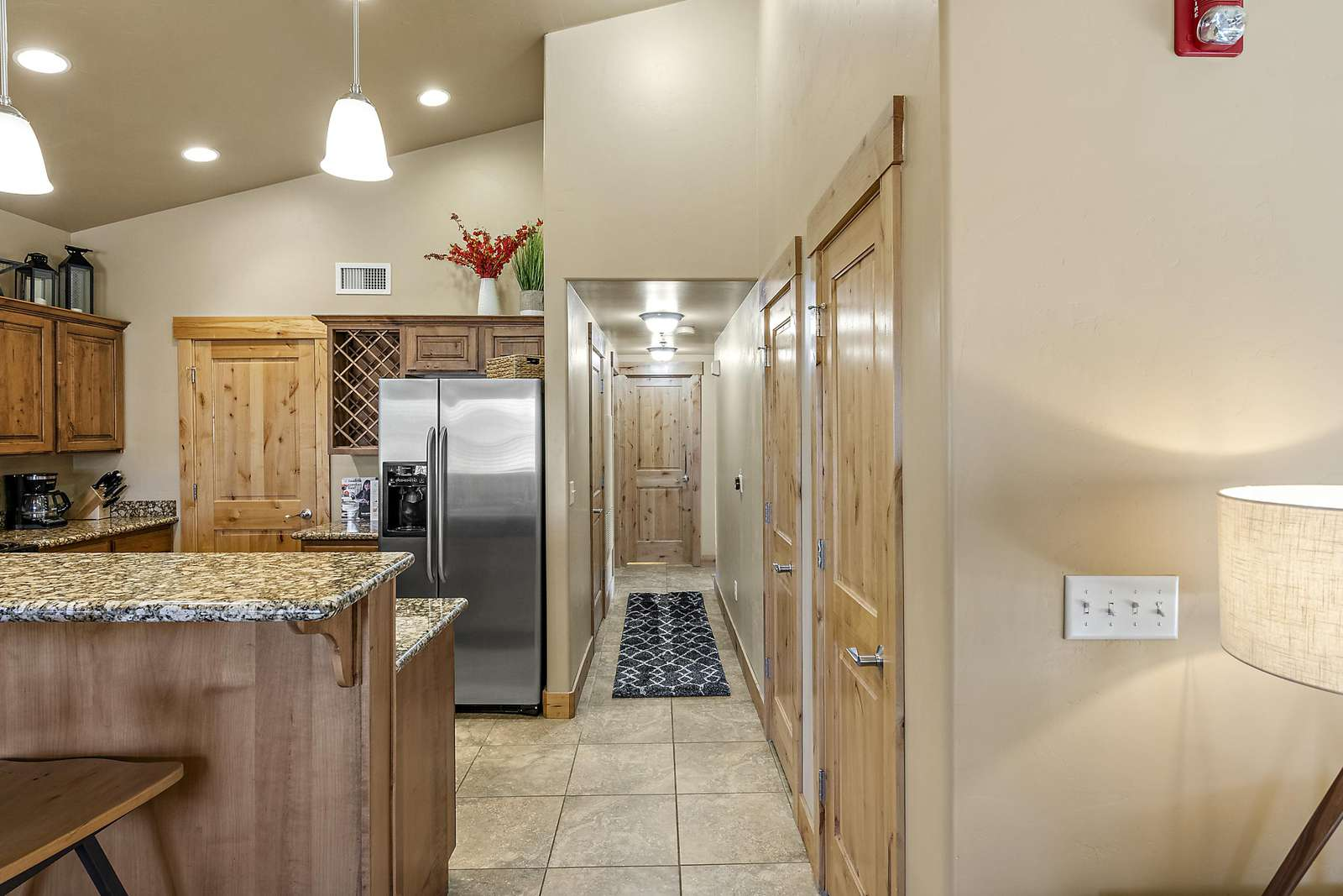 Hallway leading to guest and twin bedrooms with guest bathroom