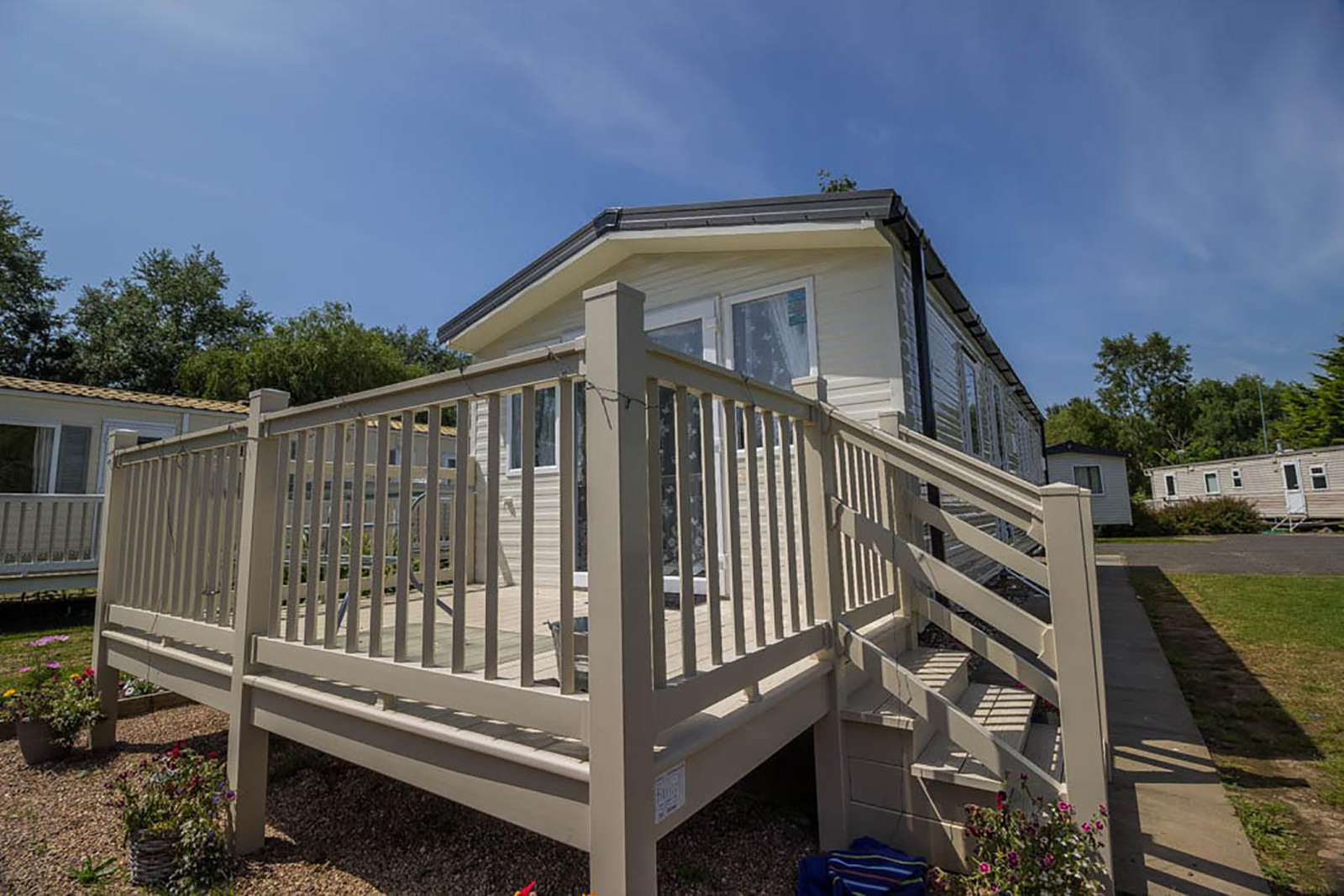 33010S – Sunrise area, 3 bed, 8 berth caravan with decking, D/G & C/H. Diamond rated. - property