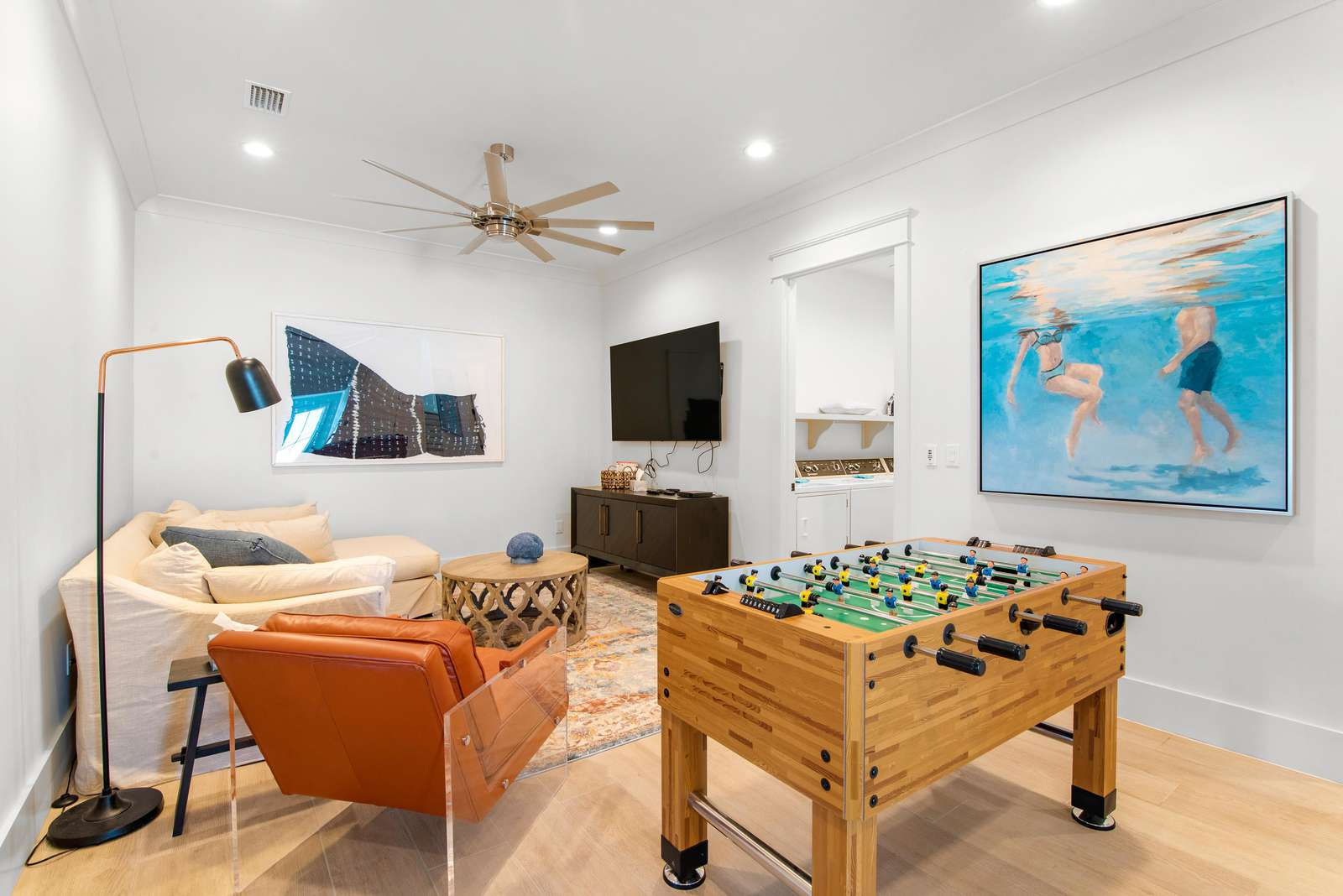 2nd Floor den with 75Inch Smart TV and Foosball Table
