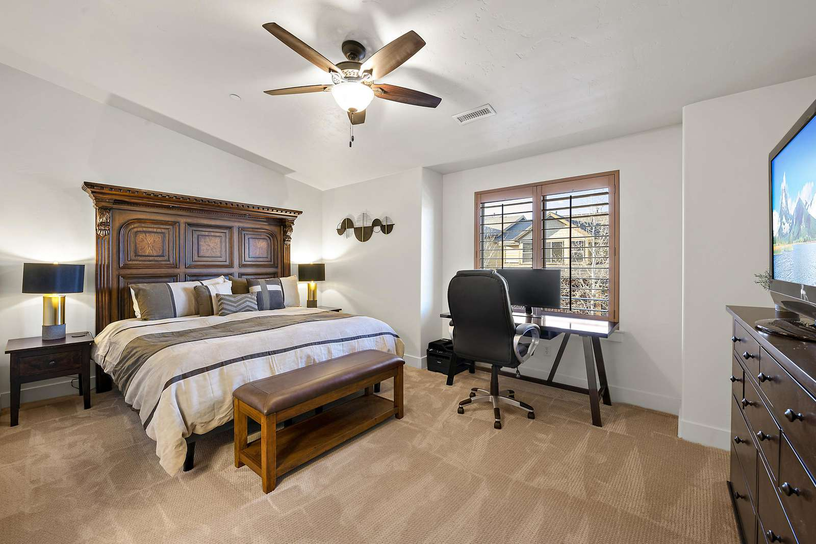 Master bedroom with work space and TV