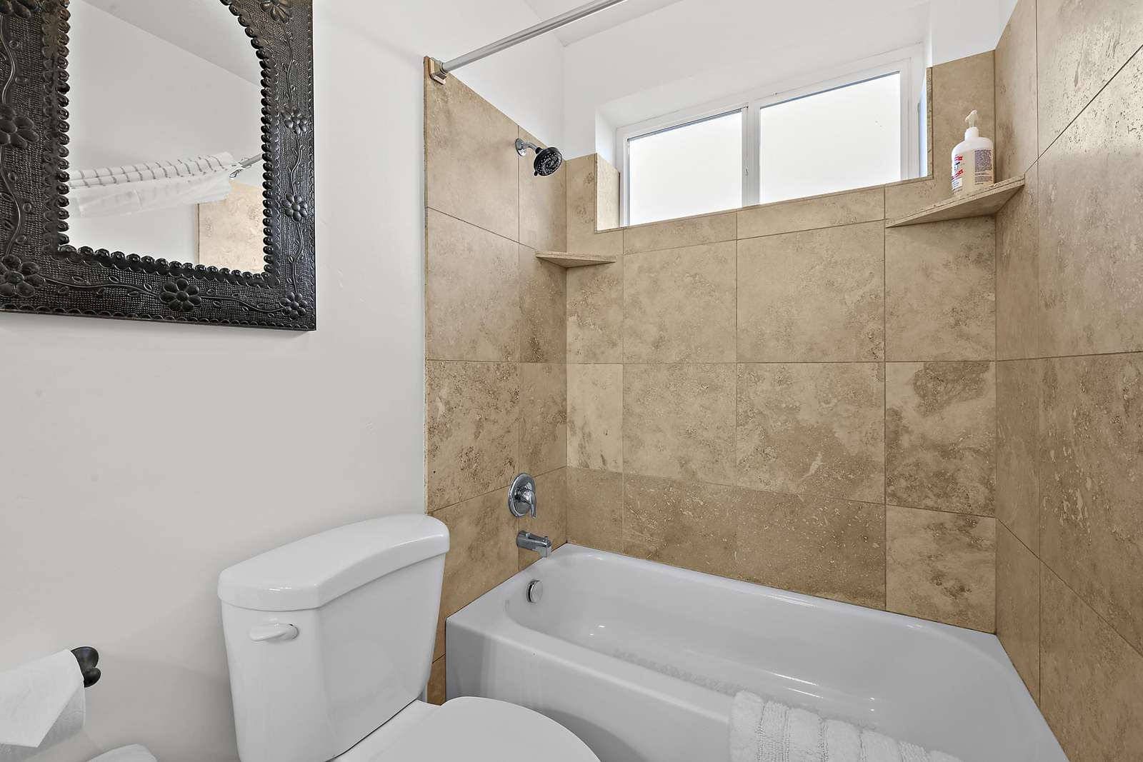 Shared Jack and Jill bathroom with shower/tub