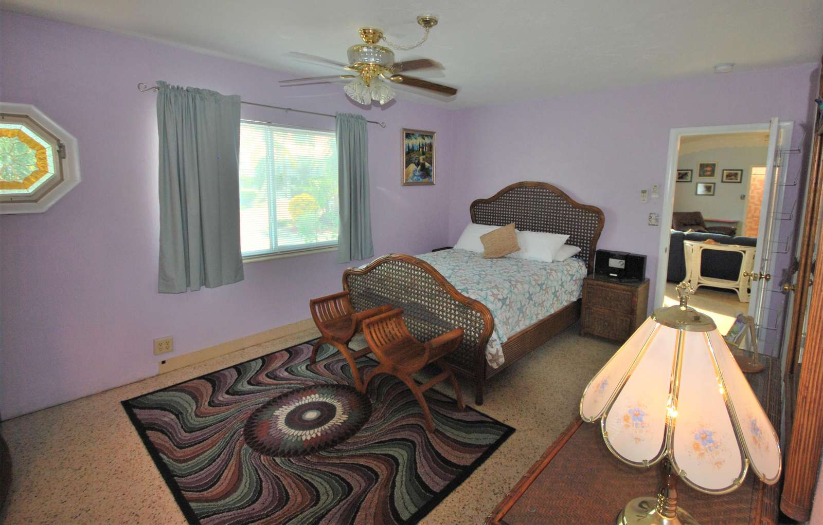 Large Master Bedroom with Queen size bed ceiling fan and private Mini-Split A/C system for comfort