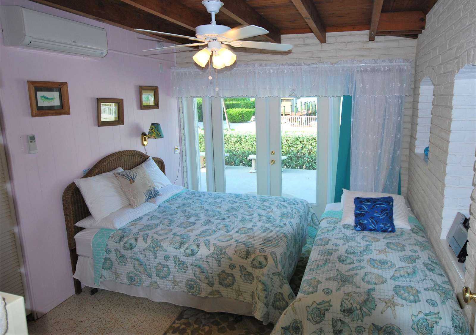 Guest bedroom #2 Queen size bed and single bed also remote Mini-Split A/C for comfort