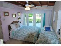 Guest bedroom #2 Queen size bed and single bed also remote Mini-Split A/C for comfort thumb