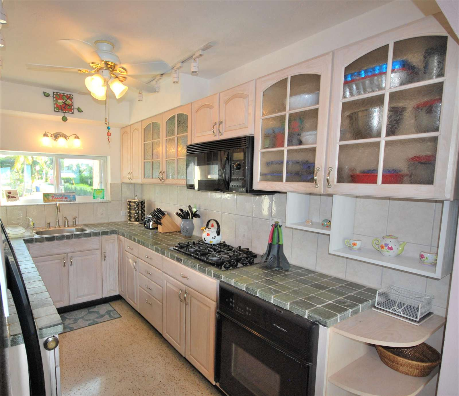 Upgraded Kitchen fully stocked with dishes has Gas rang and Oven and Dishwasher
