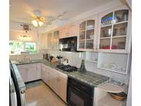 Upgraded Kitchen fully stocked with dishes has Gas rang and Oven and Dishwasher thumb