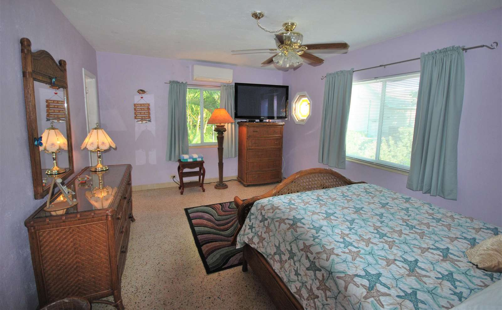 Maaster Bedroom also has dressers, ceiling fan, and largeflat screen TV