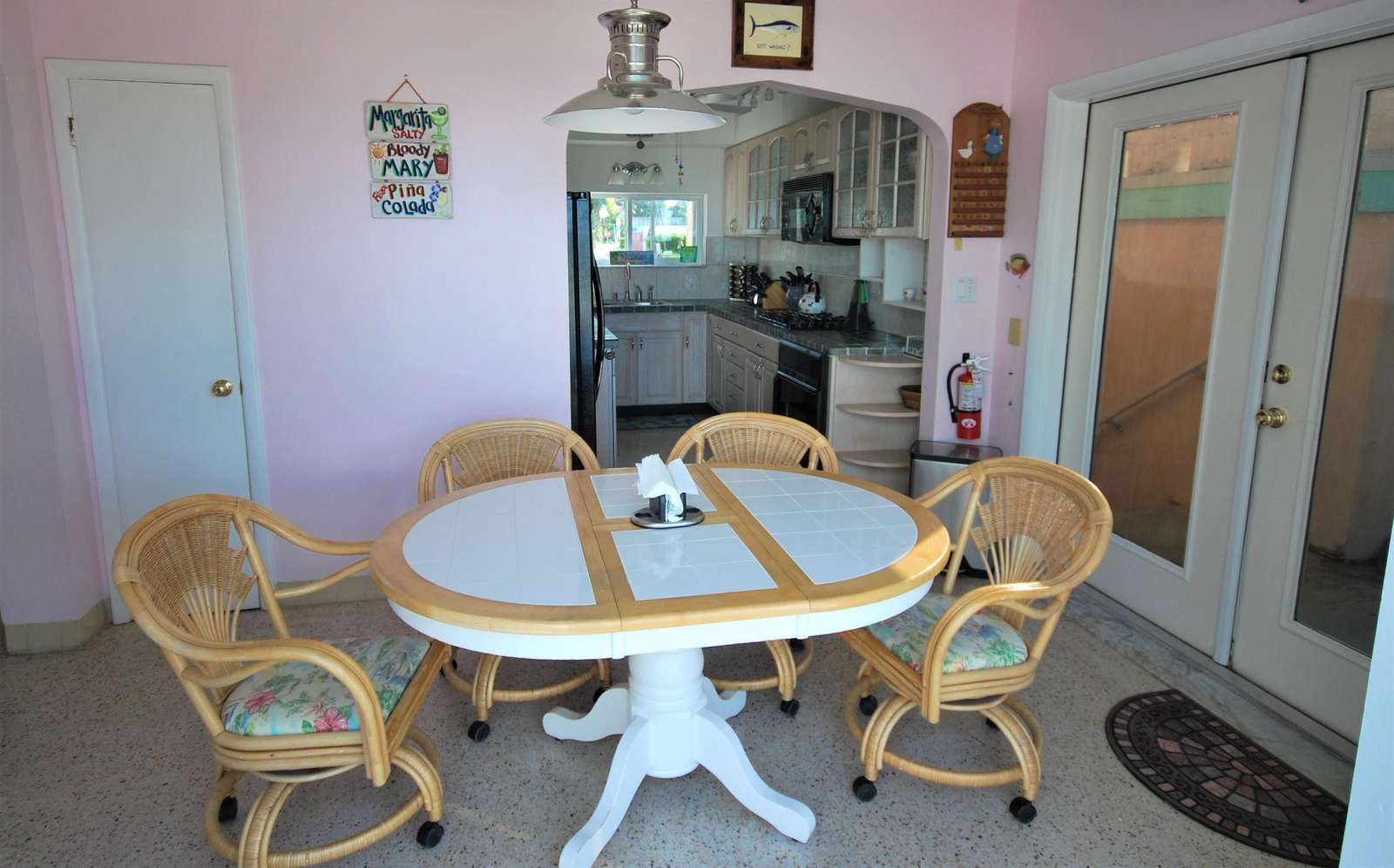 The inside dining area has walkout doors leading to the back patio for more dining space