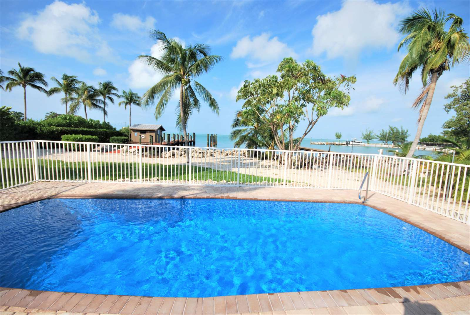 Our large 3'-6' gatted private pool Heated or Chilled with perfect open water views - property
