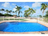 Our large 3'-6' gatted private pool Heated or Chilled with perfect open water views thumb