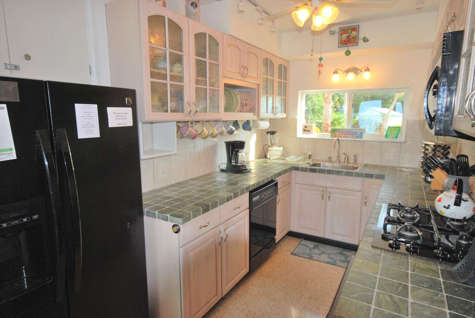 Upgraded Kitchen fully stocked with dishes has Gas rang and Oven and Dishwasher Full size Ref.