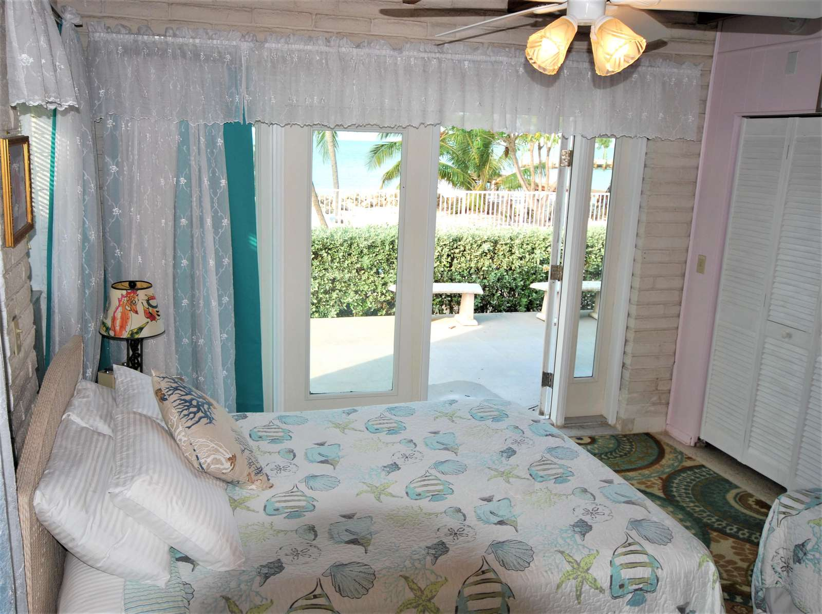 Guest Bedroom #3 has private walk our doors to the back patio/pool area