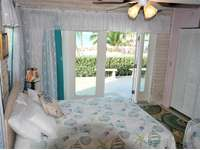 Guest Bedroom #3 has private walk our doors to the back patio/pool area thumb