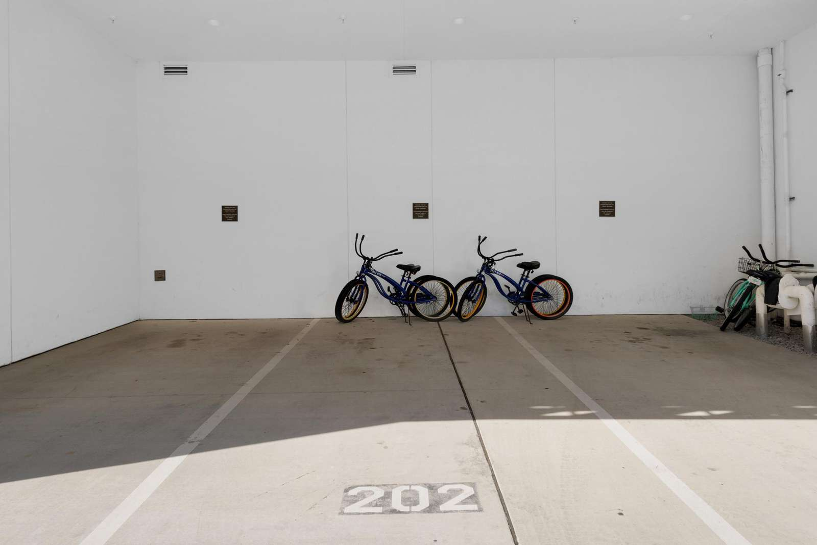 Parking space #202 with 4 adult bikes