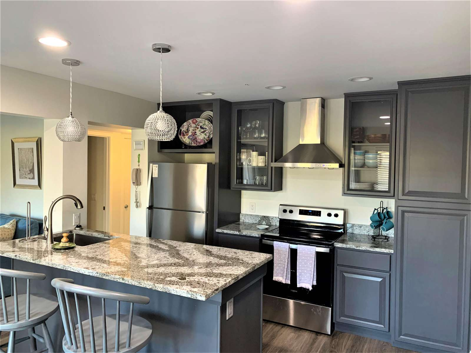 Beautiful Remodeled Kitchen with Granite Island and Stainless Steel Appliances