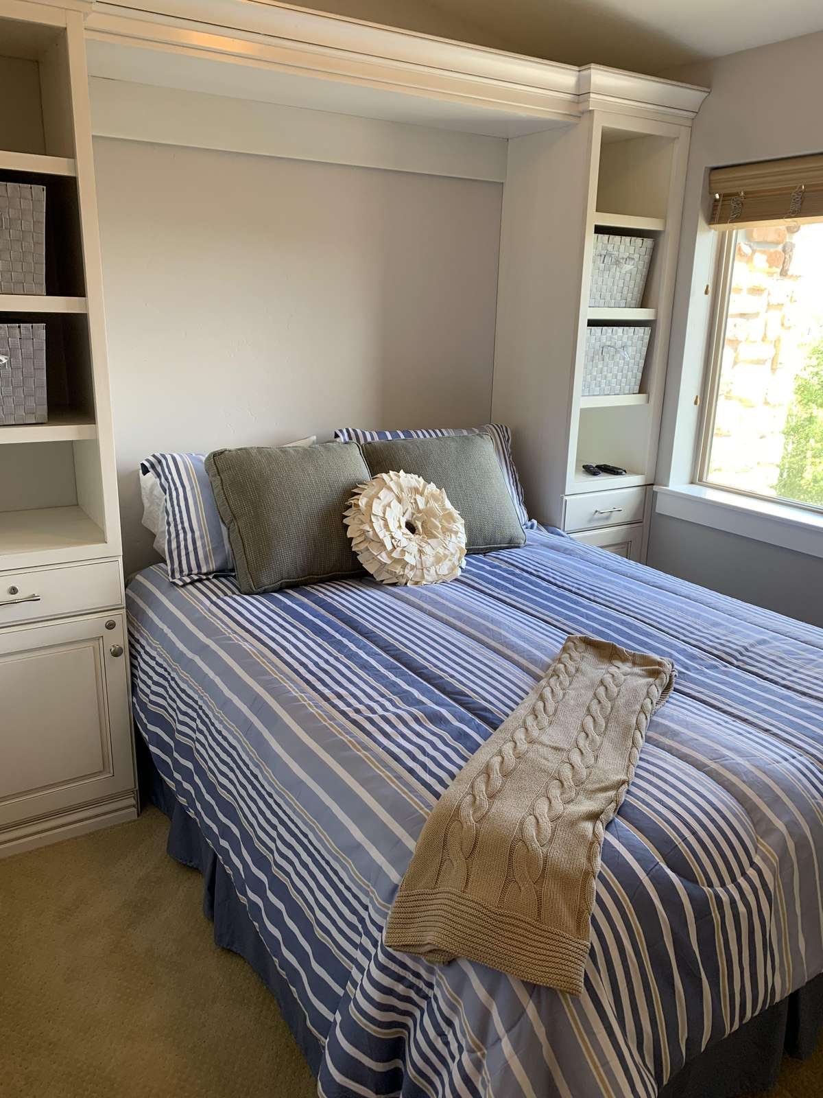 Guest bedroom with comfy queen and natural light
