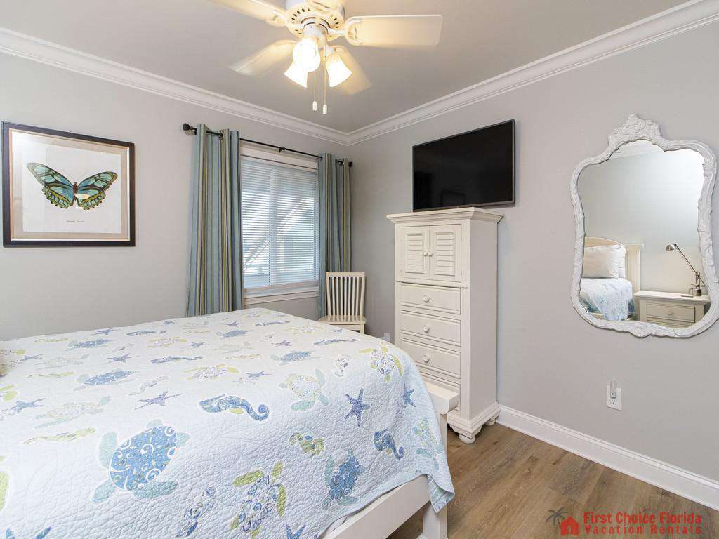 See Ray Shores - Guest Bedroom w/ TV