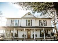 The Homestead at Dant Crossing is a 5-bedroom historic farmhouse with views of our 12-acre lake. This beautiful Bed & Breakfast is within walking distance of all campus amenities. thumb
