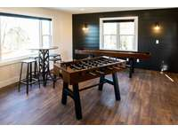 Foosball, shuffleboard, and more fill this community game room located directly behind The Homestead. thumb