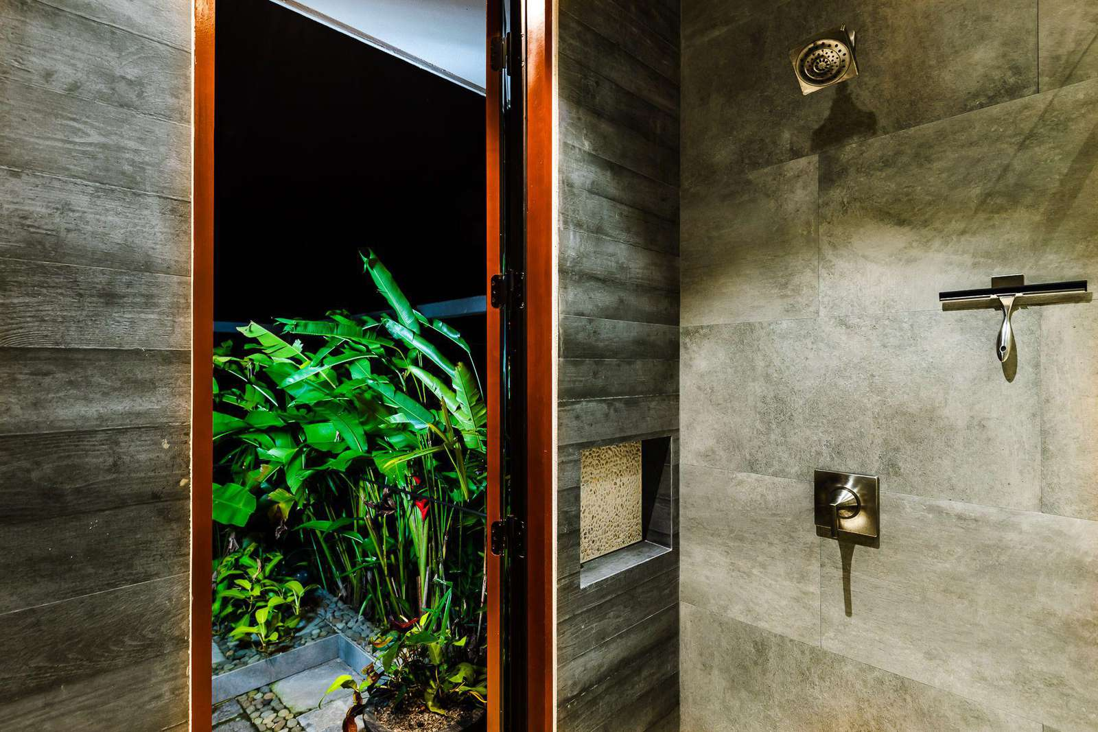 Master bathroom shower with walk out to outdoor shower