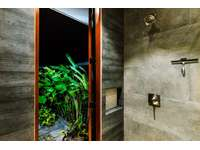 Master bathroom shower with walk out to outdoor shower thumb