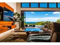 Living area, flat screen TV, ocean views, access to pool thumb