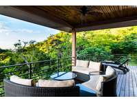 Outdoor lounge area, covered terrace, ocean views thumb