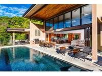 Designer infinity edge pool with ocean views thumb