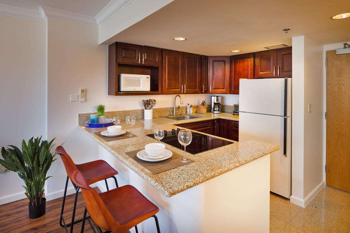 Fully Equipped Kitchen with Granite Countertops and Custom Wood Cabinets