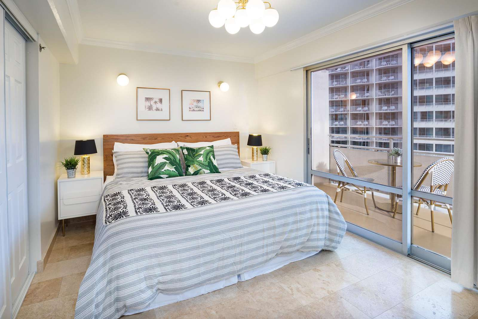 Main bedroom with king size bed and lanai/balcony access