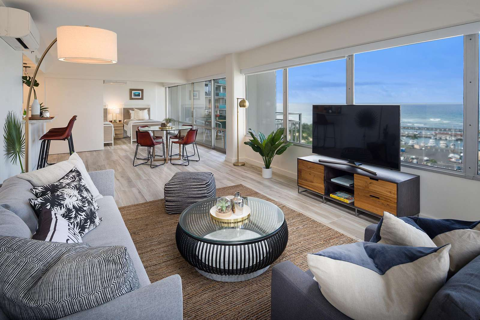 Large, spacious living / dining area - with yacht harbor and pacific ocean views behind TV!