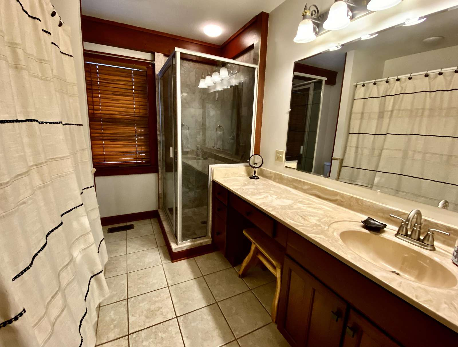 The Master Bathroom offers a Jetted Tub and Separate Tiled Shower