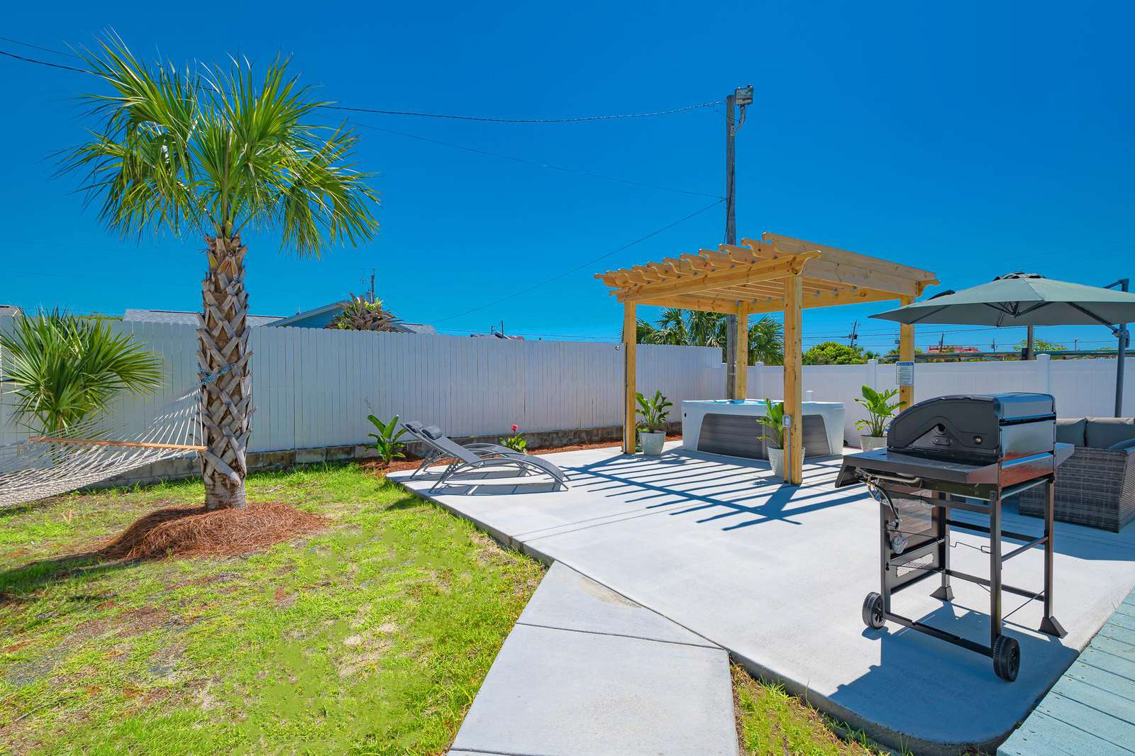 Large gas grill and lounging areas!
