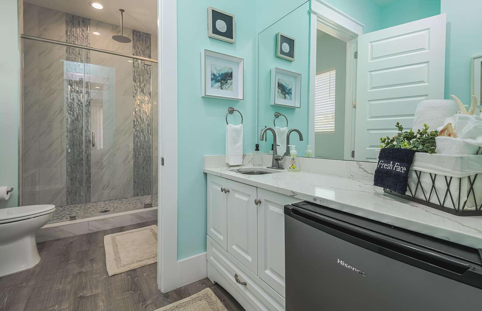 Your private master bath with economy fridge!