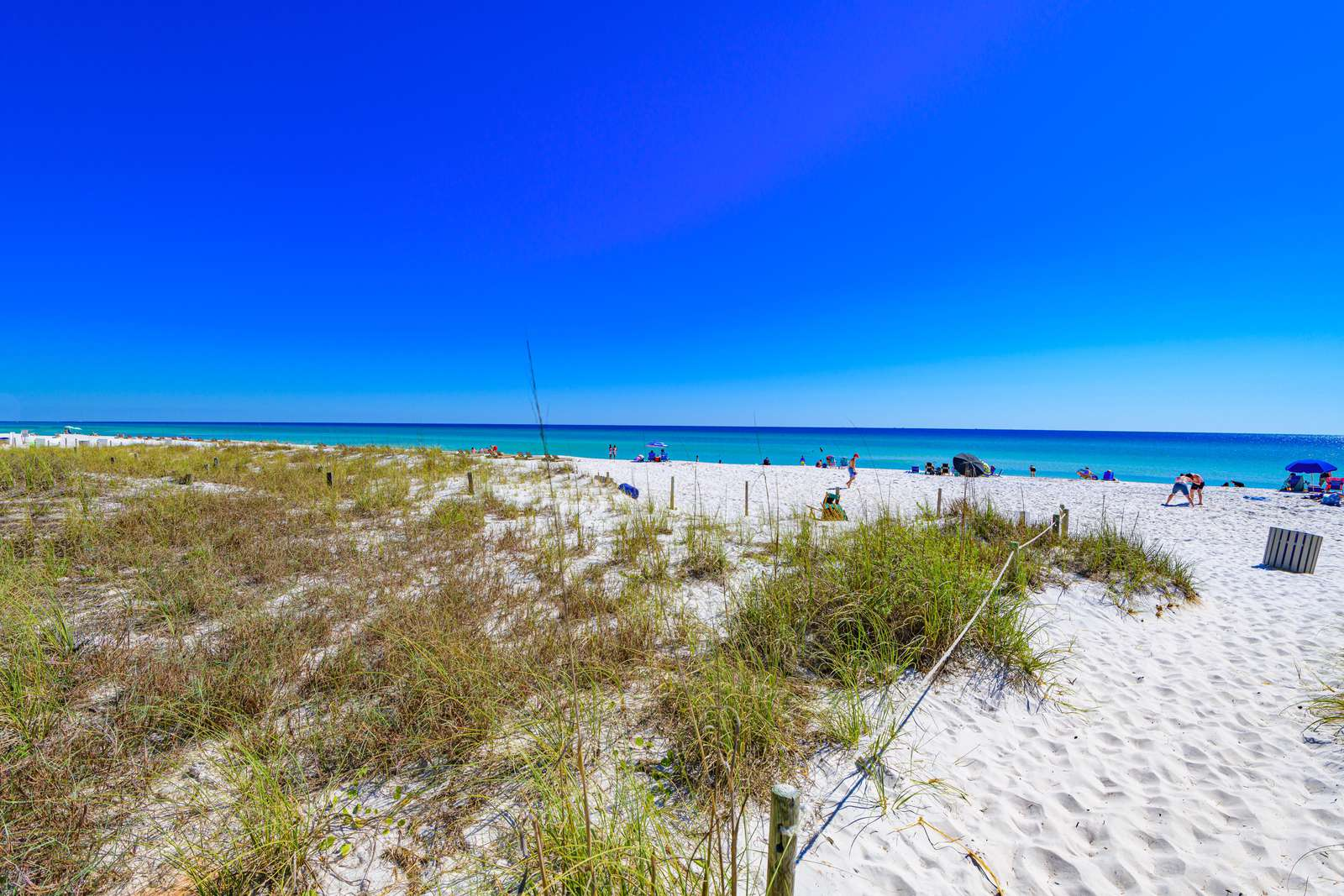 Stunning natural dunes, sugar sands and emerald waters!