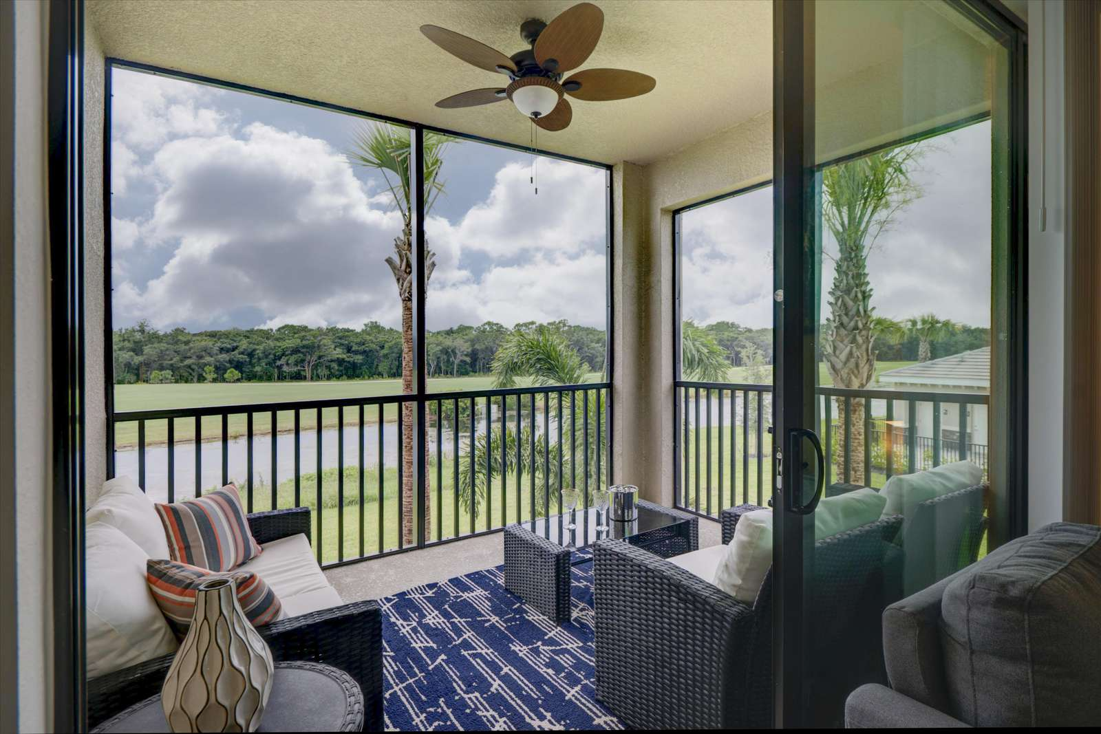 What a beautiful view from the lanai to golf & lake - property