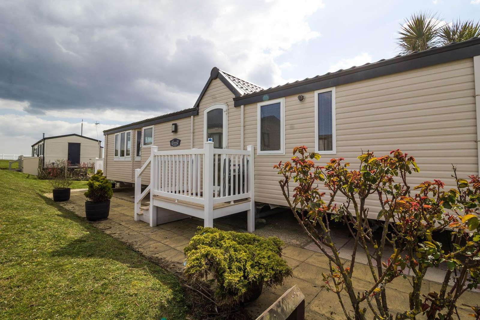 80033L – Lansdown area, 2 bed, 6 berth caravan with decking, D/G & C/H. Diamond rated. - property