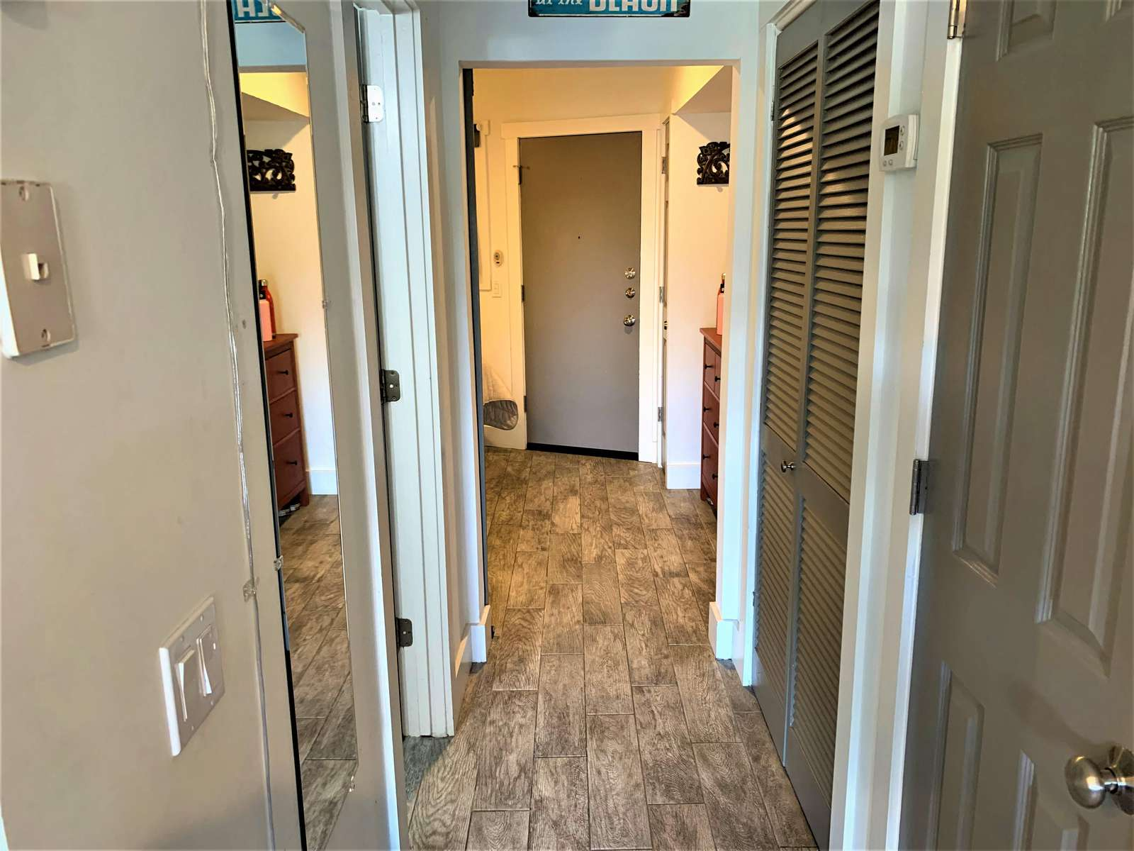 Ceramic Tile with Wood Floor Look Throughout
