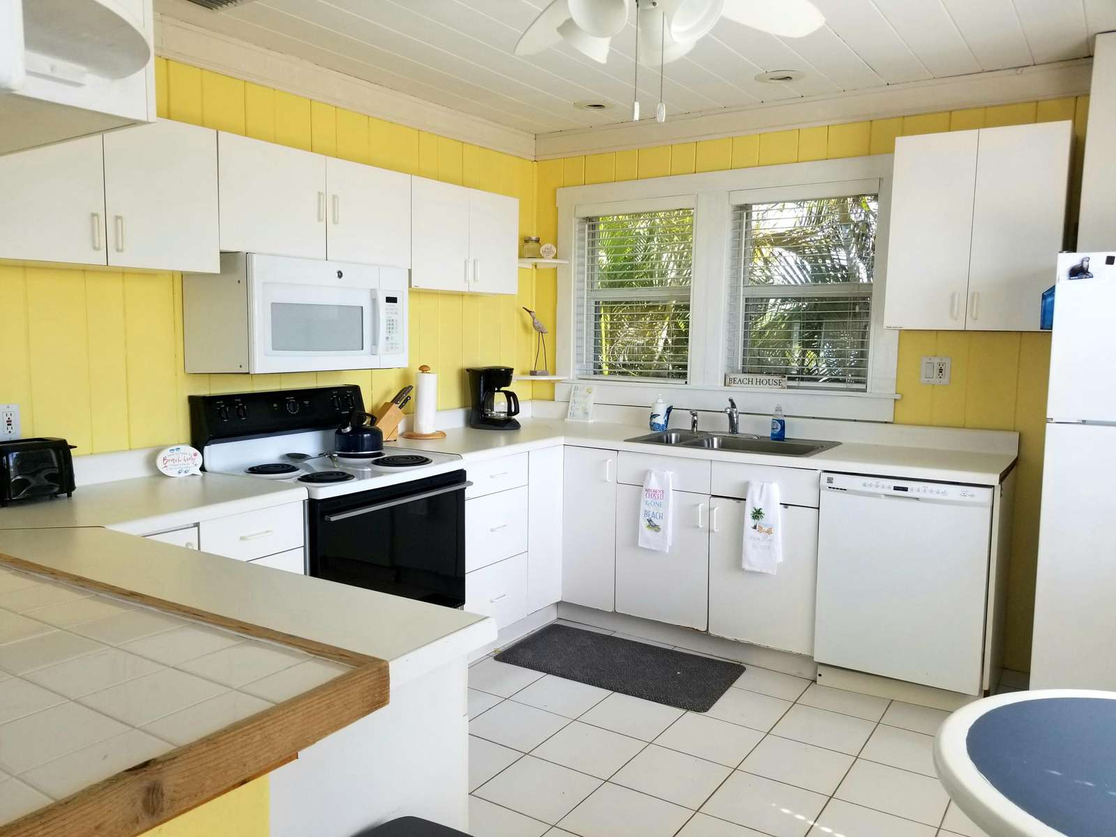 Kitchen is equipped with fridge, microwave, stove, oven and coffee maker
