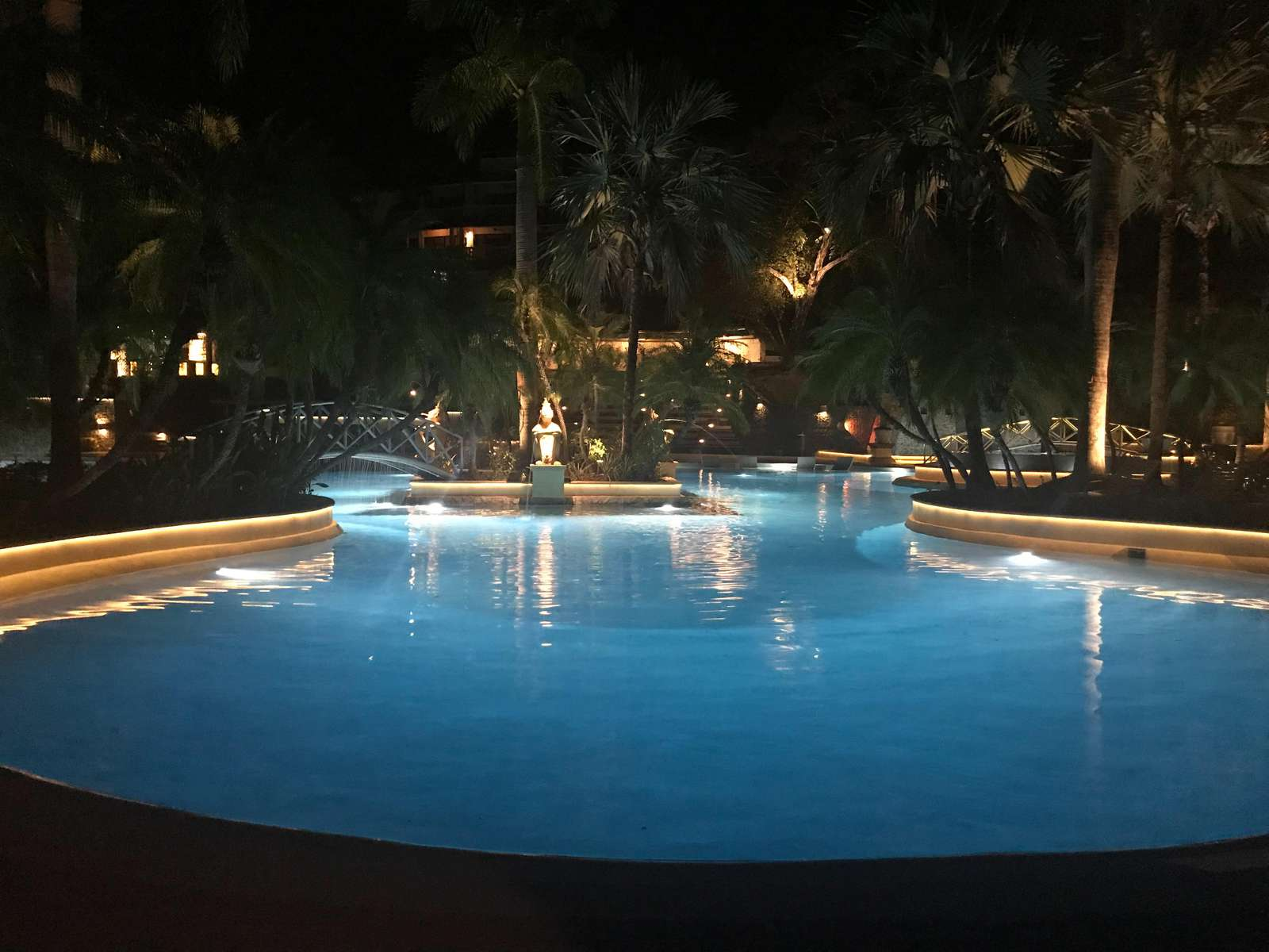 After dark at the 10,000 SF free form pool at the Diria Resort