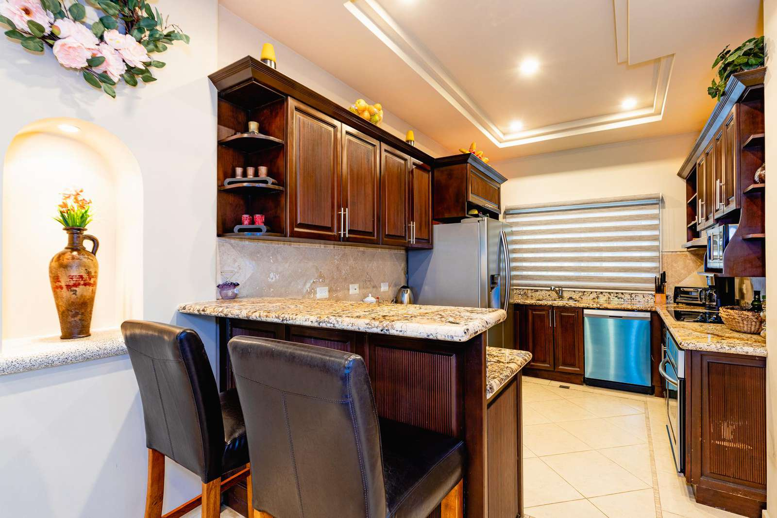 Fully stocked gourmet kitchen with breakfast bar
