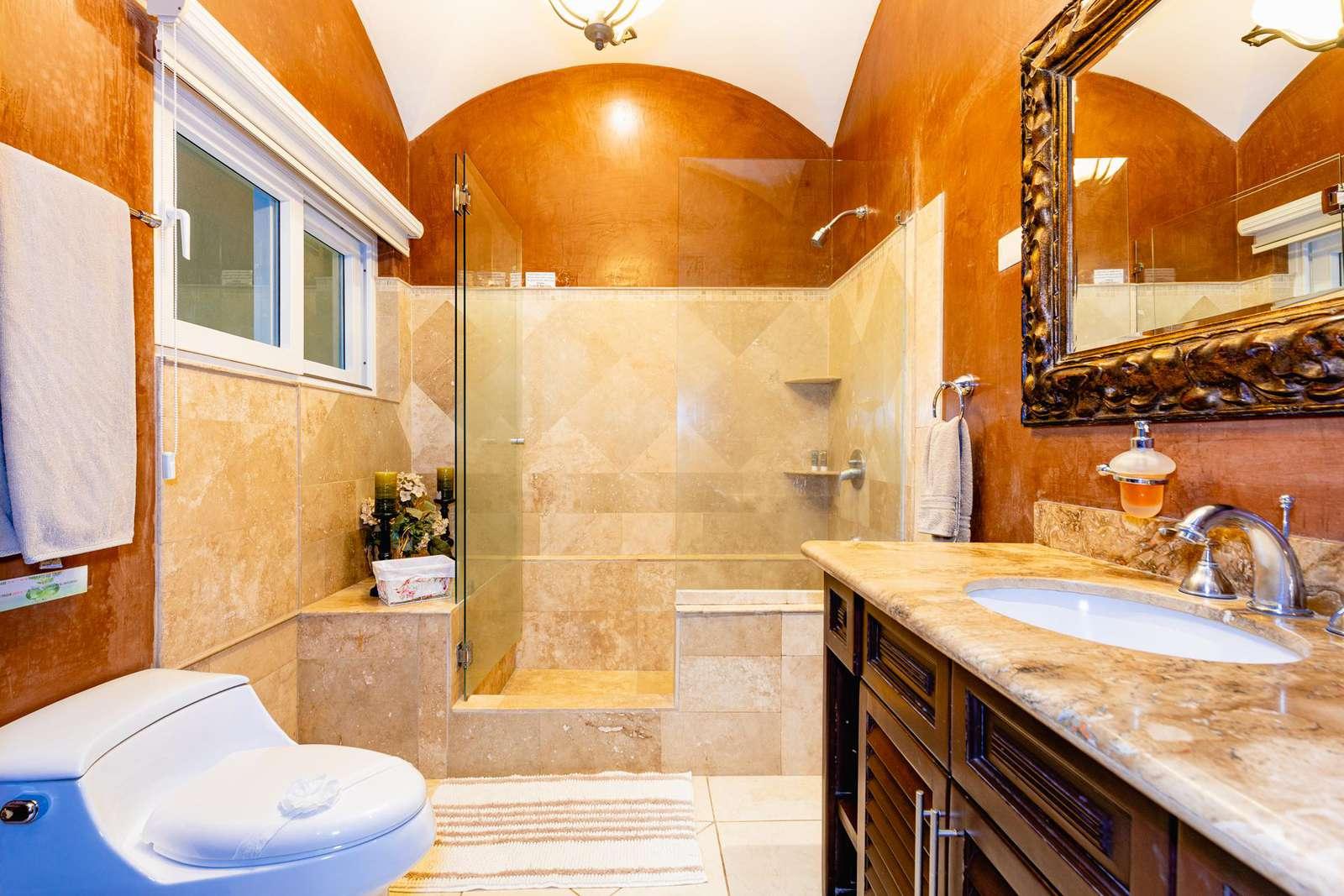 Master bathroom with oversized walk in shower & marble vanity