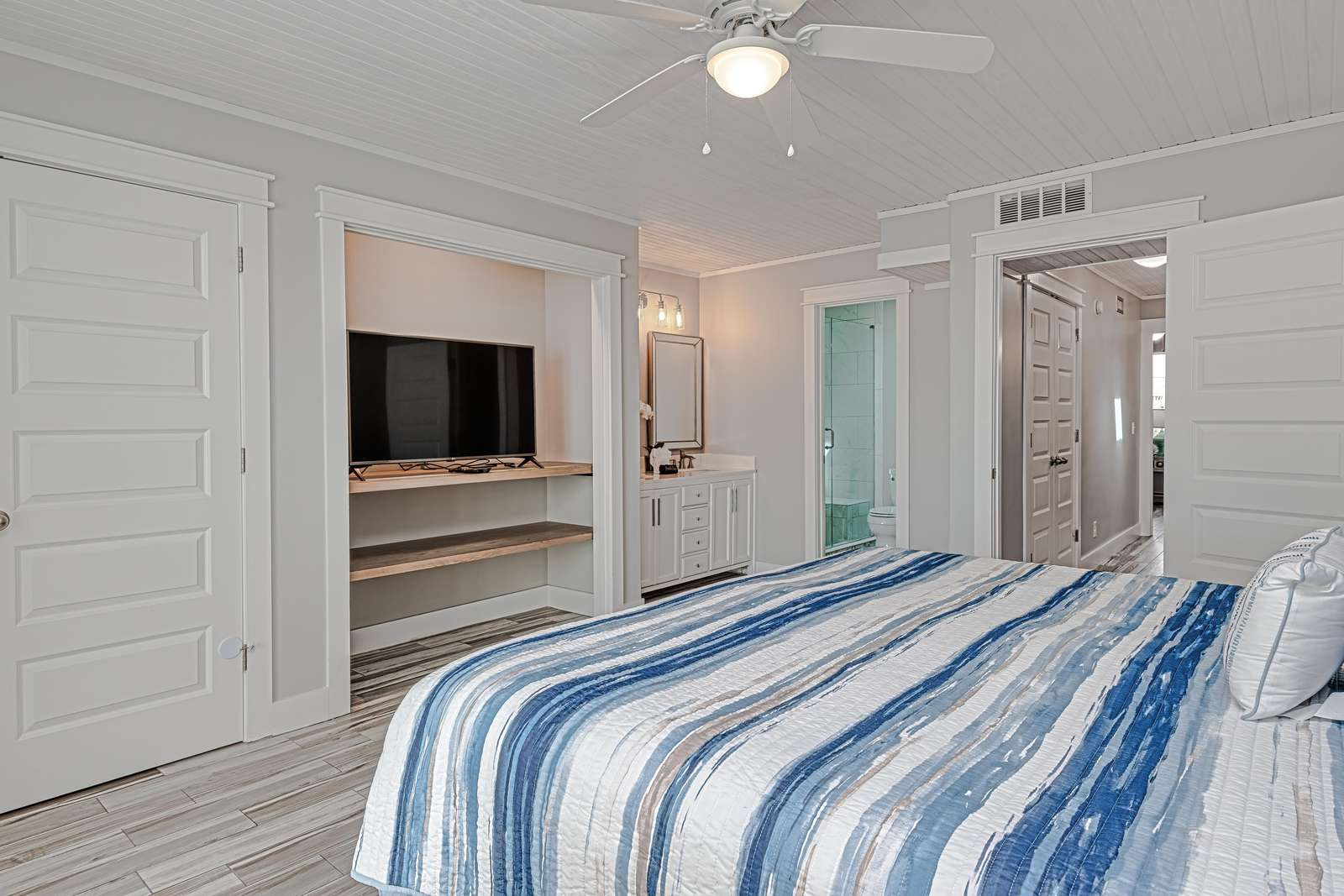 Spacious master bedroom with large smart TV!