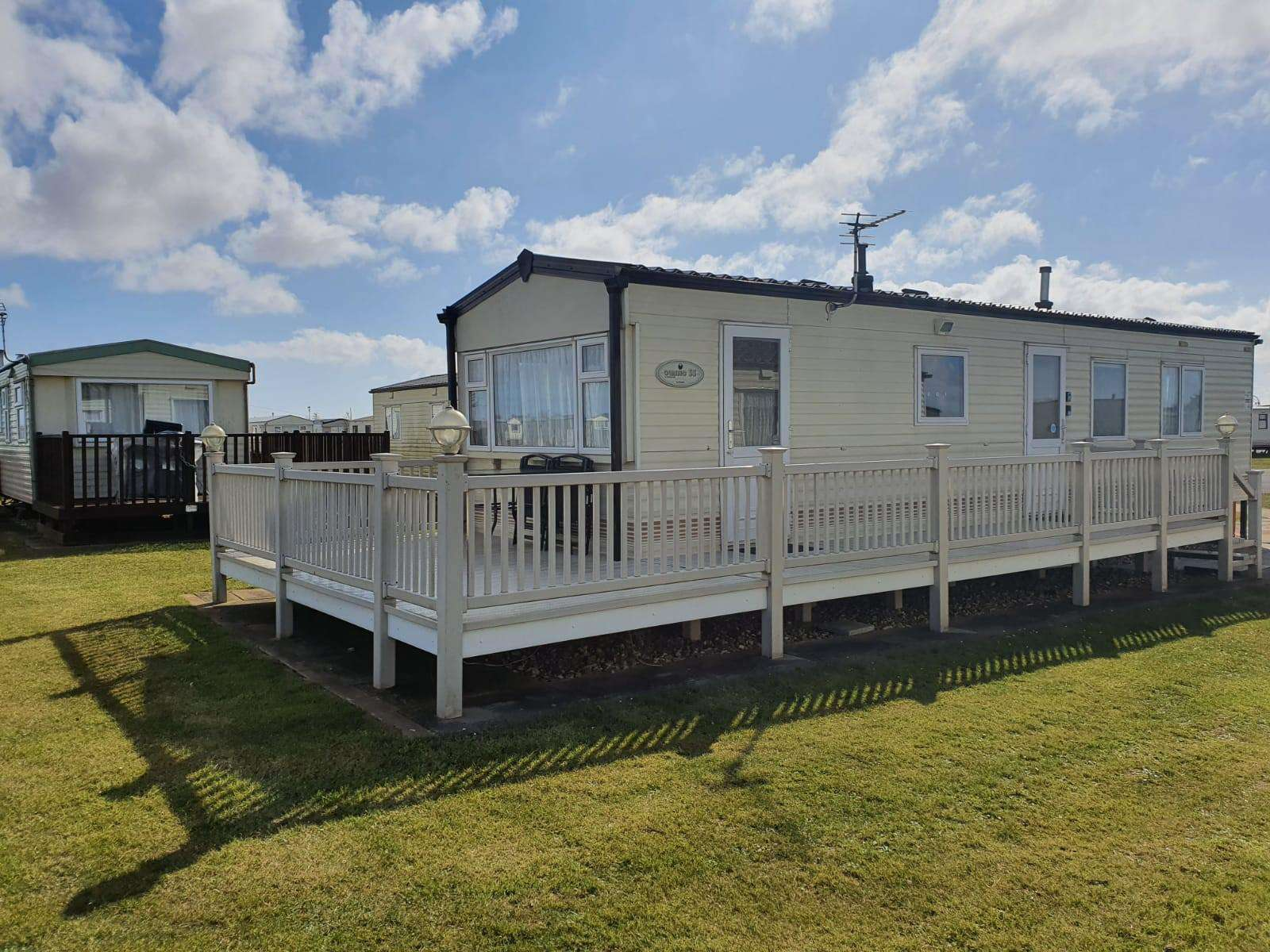 53030G – The Grange, 3 bed, 6 berth caravan with decking. Emerald rated. - property