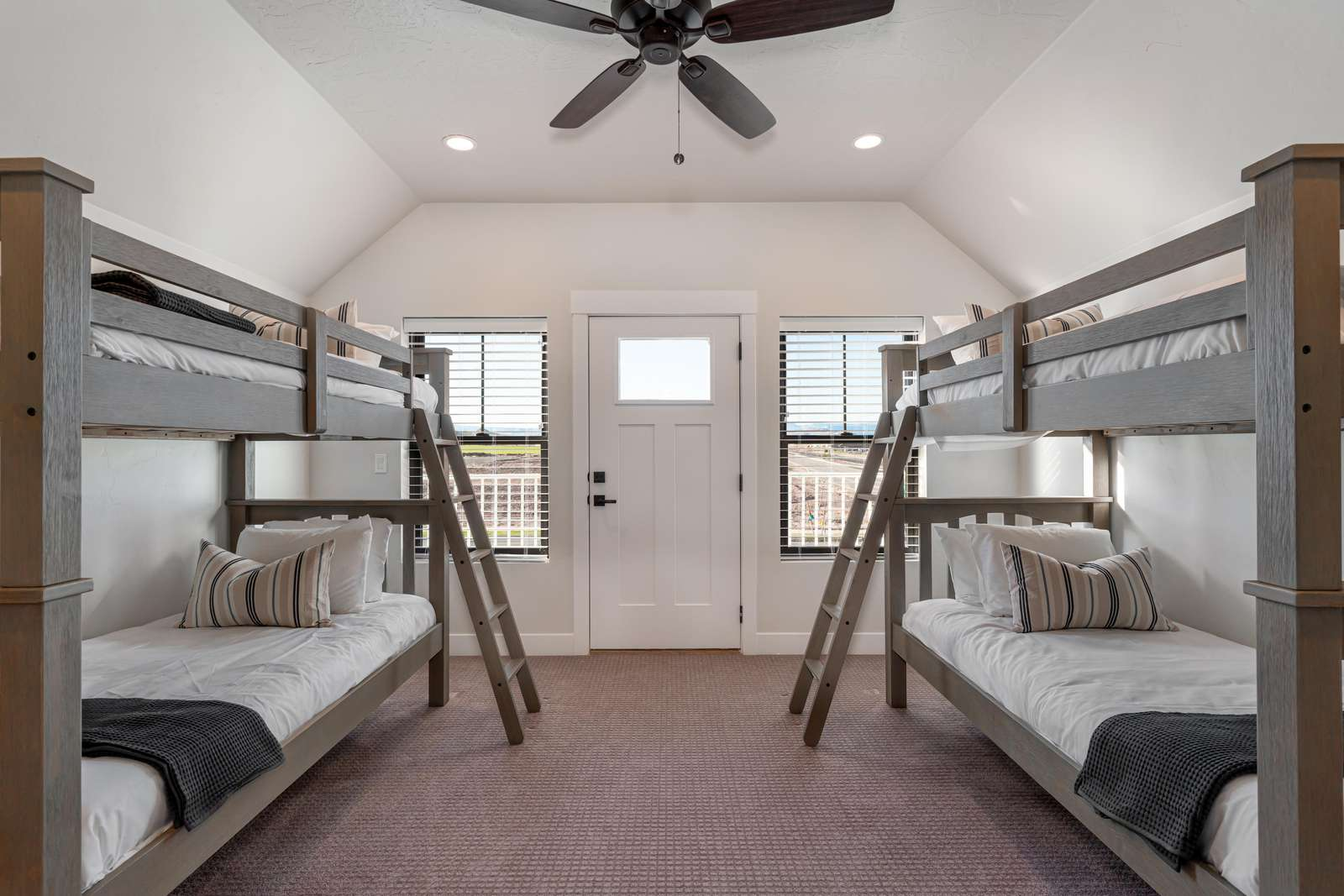 Bunk Bedroom features 2 bunkbeds and a door leading out to the front 2nd story balcony