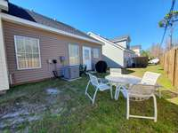 Back yard with table and chairs for 4, gas grill thumb