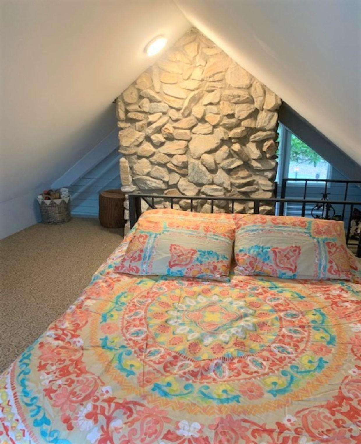 Loft bedroom with full bed