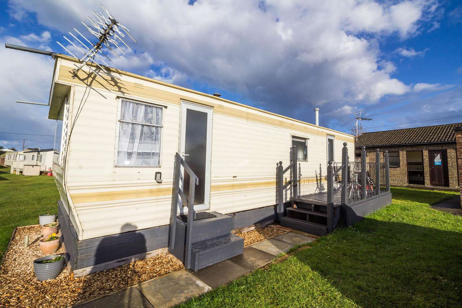 48086B – Beach Estate, 2 bed, 4 berth caravan with decking. Emerald Rated. - property