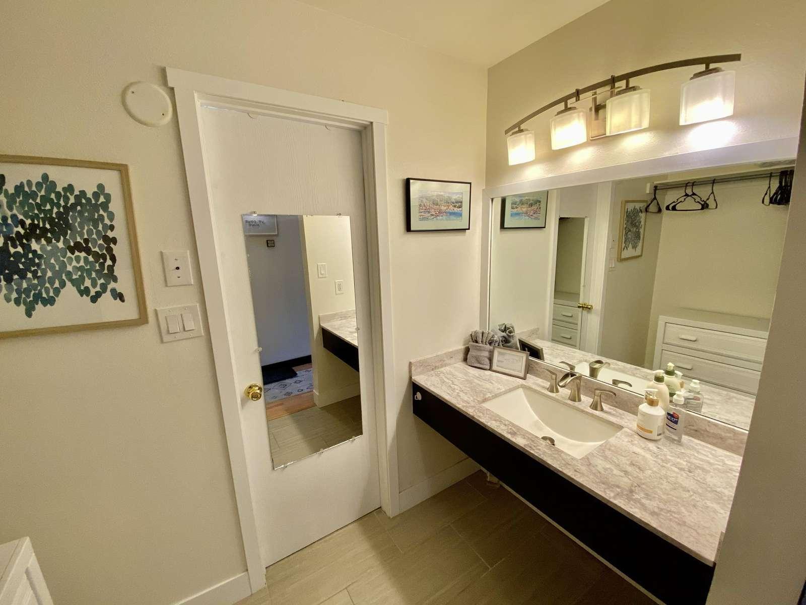 Private bathroom beyond prep room